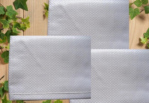 为什么编织袋厂家都放弃钛白粉,选择了荧光增白剂
